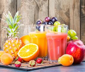 Fresh juice on wooden table