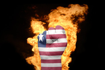 fire fist with the national flag of liberia