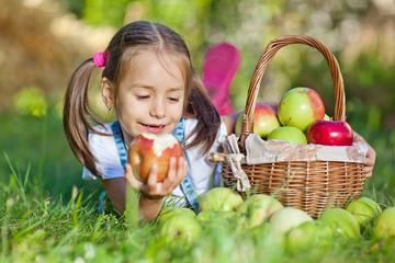 Beautiful girl in apple garden