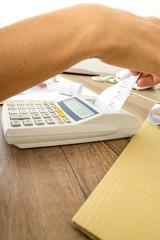 Closeup of business accountant or financial adviser making calcu