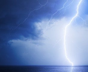 Seascape with bright lightning in blue sky
