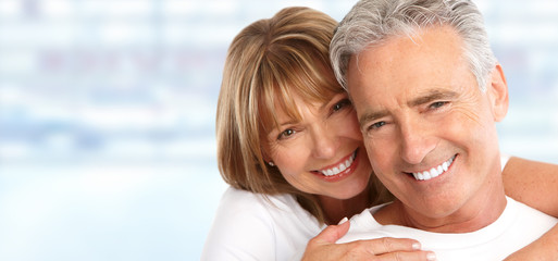 Elderly couple with white teeth.