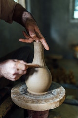 The ceramist make jug from clay