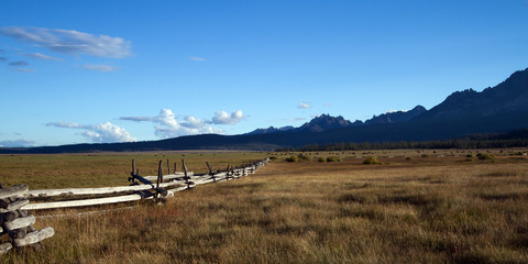 Fields, fences, and the Sawtooth Mountains near Stanley, Idaho