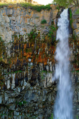 Water gushes down a colorful rock wall in Centennial Waterfront Park in Twin Falls, Idaho