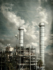 aged vintage photo of industrial factory smokestacks and pollution