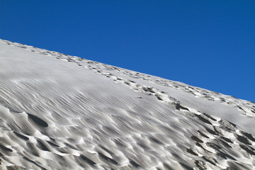 Foot prints and wind patterns in White Sands National Monument in New Mexico