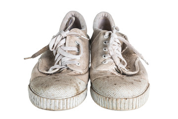 Close up a pair of dirty sneakers isolated on white background.