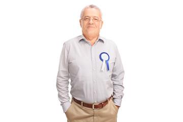 Proud senior posing with blue award ribbon