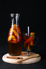 the peach compote on the Board with cinnamon on a black background