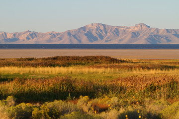Great Salt Lake and Wasatch Mountains at sunset from Antelope Island State Park in Utah