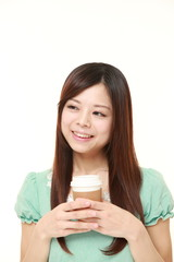 Japanese woman takes a coffee break