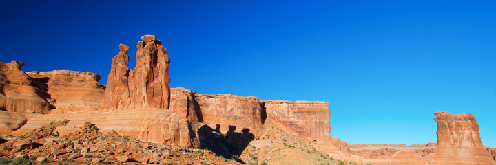 Panorama with shadow of The Three Gossips rock formation in Arches National Park near Moab, Utah