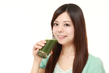 woman with green vegetable juice