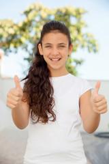 Smiling teenager girl saying ok