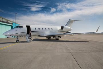 executive business woman leaving a corporate jet plane