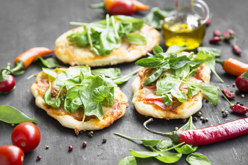 Mini Pizzas with Mozzarella,Spinach and Fresh Basil