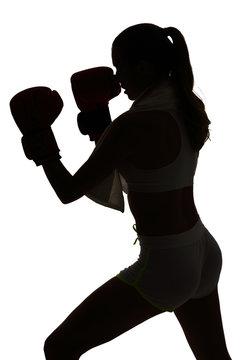 one caucasian woman boxing exercising in silhouette studio isola