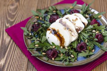 Arugula salad with mozzarella raspberries pine nuts and balsamic vinegar dressing