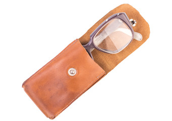 old glasses in a leather case, isolated