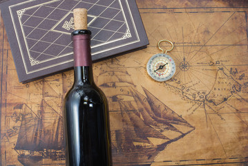 bottle of wine  on the background of old maps