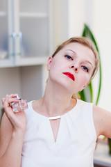 Beautiful girl is testing a new perfume