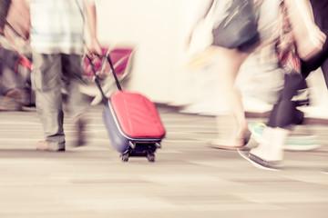 Blur motion of passengers walking at airport