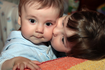 two kids kissing