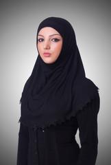 Muslim young woman wearing hijab on white
