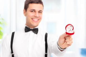Elegant man proposing with an engagement ring