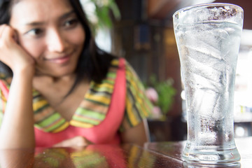 Young Woman with glass of fresh Water