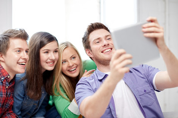 group of happy high school students with tablet pc