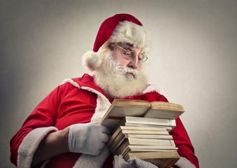 Santa Claus reading books