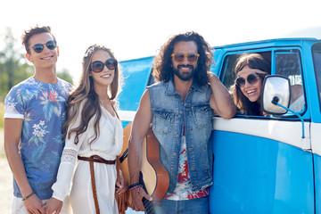 happy hippie friends with guitar over minivan car
