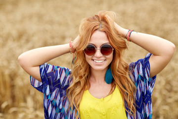 smiling young redhead hippie woman outdoors