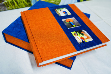 blue and orange textile wedding photo book and album