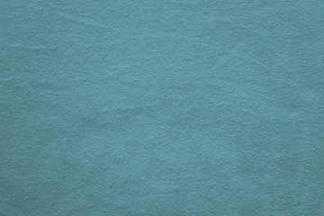 texture knitted fabric of dark turquoise color