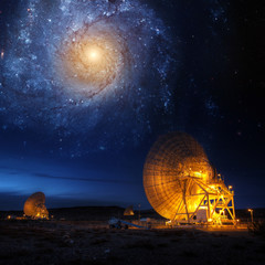 Satellite Antenna under beautiful star in blue sky. Elements of this image furnished by NASA.