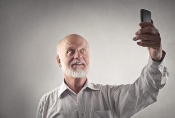 Elderly man doing a selfie