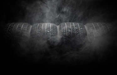 Close-up of car tires with smoke