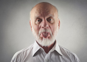 Elderly man making funny jokes