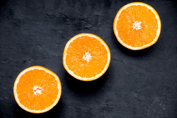 Beautiful Oranges Fruit  Sliced on old  table. rich with vitamins. background, texture.