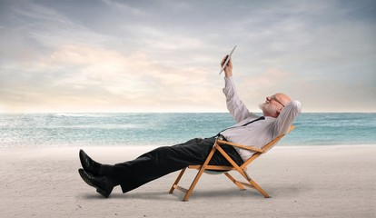 Relaxed businessman lying at the beach