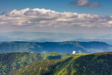 The formation and movements of clouds up to the steep slopes of the  mountains of Central Caucasus peaks.
