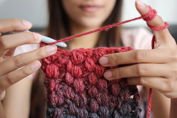 A girl showing how to crochet