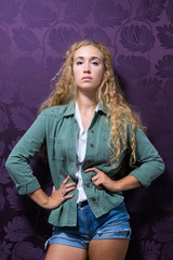 Young Woman Wearing Denim Jacket And Shorts