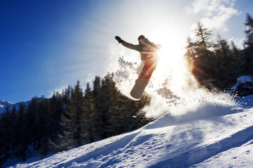 Poster Winter sports Powerful image of a snowboarder jumping over a kicker in the backcountry powder