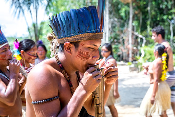 Native Brazilian people dancing at an indigenous tribe in the Amazon