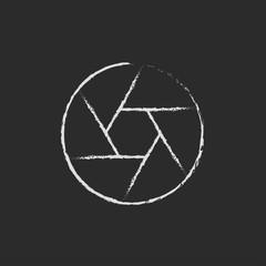 Camera shutter icon drawn in chalk.