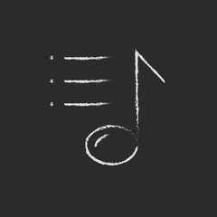 Musical note icon drawn in chalk.